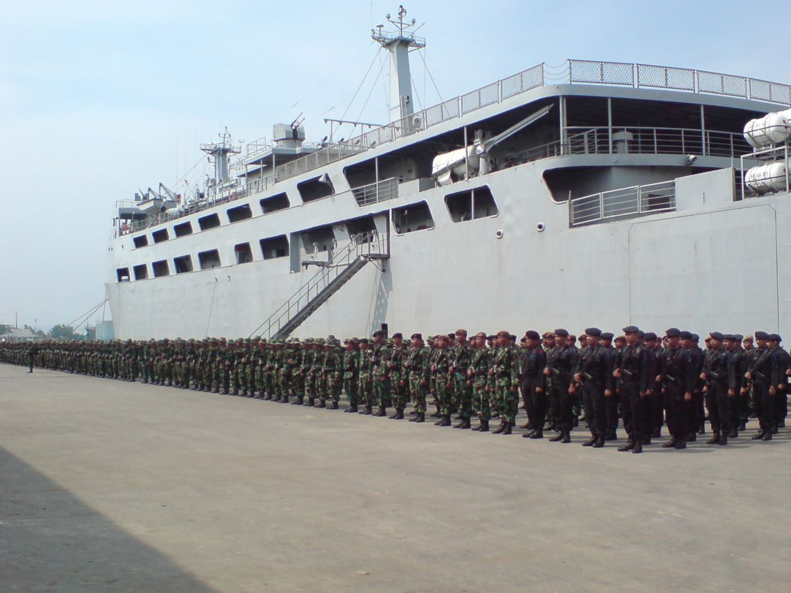 About 500 soldiers stand in military formation at a port on Java after disembarking from their transport ship carrying them home after months of duties in remote malarious eastern Indonesia. Almost half of the soldiers standing here have dormant hypnozoites of Plasmodium vivax in their livers --180 of them volunteered for a randomised trial of primaquine against further relapse during one year of follow up on malaria-free Java. The Eijkman Institute of Molecular Biology closely collaborates with the health research services of the Indonesian Armed Forces and EOCRU has helped develop this unique experimental model for a number of trials involving drugs, vaccines, and diagnostics.