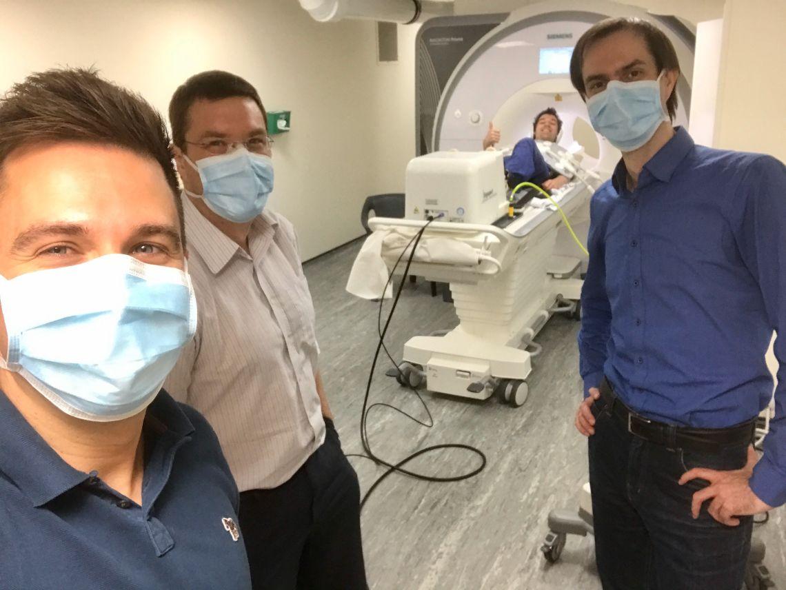Selfie of researchers undertaking practice run of the ergometer in the MRI machine