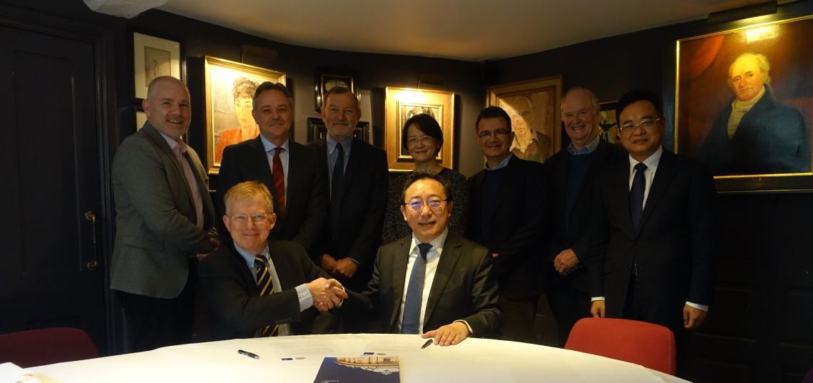 Back row: Darren Nash, Jeremy Farrar, Chris Conlon, Tao Dong, Vincenzo Cerendolo, Andrew McMichael, Jianwei Wang. Front: Richard Cornall and Xuetao Cao