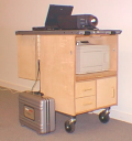 The Evidence Cart: a wooden cabinet containing medical equipment