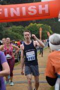 Male runner at finish line