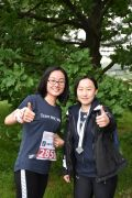 Two female runners giving thumbs up signs