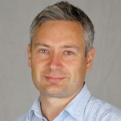 Colin J Akerman