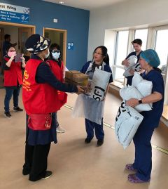 Ying Cui and her colleagues donating protective equipment to NHS staff at the John Radcliffe Hospital in Oxford.