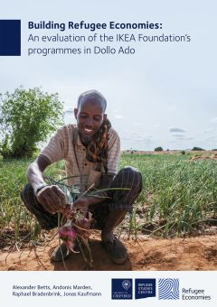 Report cover showing farmer in Melkadida agriculture cooperative harvesting onions
