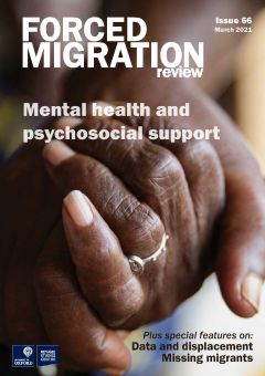 The cover of Forced Migration Review 66 showing the hands of two people clasped together