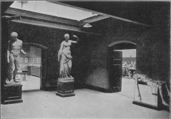 Empty room with two marble statues