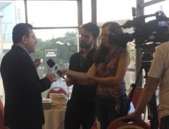 Arturo responding to journalists