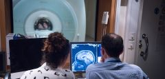 Two people working in MRI scan room