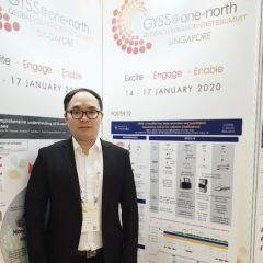 A photo of attendee Yibin Liu in front of the poster he is presenting at the Global Young Scientists Summit