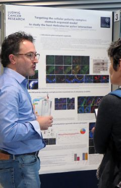 Ludovico Buti presenting his poster at the CRUK Oxford Centre Symposium