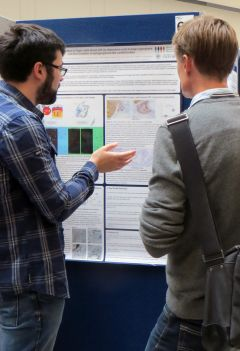 Student presenting his poster at the CRUK Oxford Centre Symposium