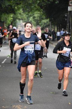Female runner waving