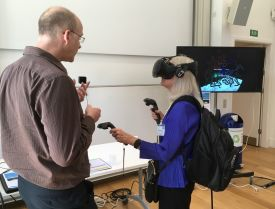 Prof Kay Davies (MRC Scientific Advisory Board) tries out the VR headset