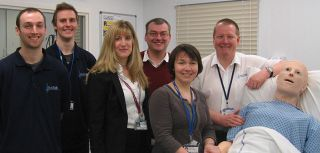 OxSTaR team with a medical manikin. Left to right Charlie McDermott, Russ Sinclair, Helen Higham, Paul Grieg, Rosie Warren, Alan Inglis and the medical manikin.