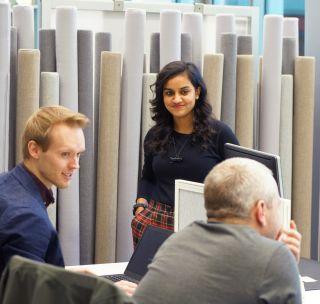 BioEscalator tenants chatting at the hotdesks