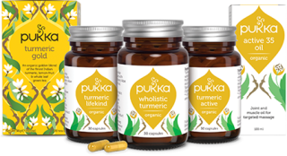 Three bottles of Pukka Turmeric Gold, and a packet of tea with the same branding in a yellow box