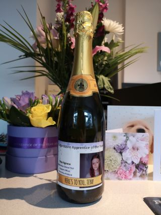 Congratulations cards, a bottle of champagne and a bunch of flowers