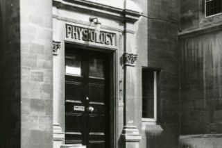 Old entrance with Physiology sign above the door