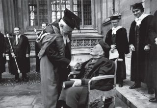 Mabel FitzGerald pictured in a wheelchair shaking hands with the Chancellor