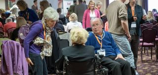 Patients carers and researchers discuss a rare form of motor neuron disease
