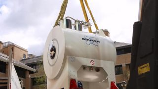 The new small-animal scanner for our Wellcome Centre for Integrative Neuroimaging is lifted into place at the Biomedical Services Building