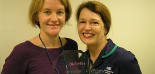 Dr Lucy MacKillop (Nuffield Department of Obstetrics and Gynaecology) and Katy Bartlett (John Radcliffe Hospital) recieve the QiC award for 'best digital initiative'