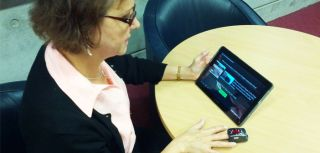 A patient trials the tablet-based digital mobile health system