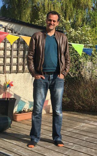 Jamie standing in his garden at home
