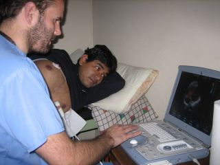 Dr Tom Smith measuring a volunteer's pulmonary artery pressure during an experiment in Peru