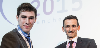 Joel (left) is pictured receiving his award from Mr Ian Pearce at the BAUS 2015 Annual Meeting