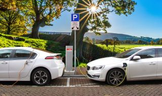 Two electric cars at a charging point