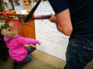 A child taking part in the 'Sing Song Physics' activity