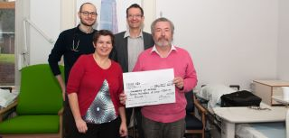 Mr Ken Thompson presents the £750 cheque to the Future 5 team, Professor Paul Bowness, Dr David Simone and Ms Alice Harin.