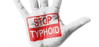 Stop typhoid message painted onto a hand