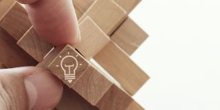 Light bulb icon on a wooden block puzzle