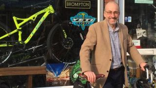 Prof Simon Lovestone cycles to Buckingham Palace to receive knighthood