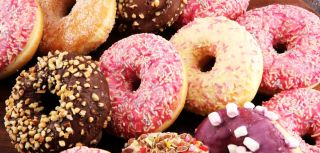 Taxing high sugar snacks such as biscuits, cakes, and sweets might be more effective at reducing obesity levels than increasing the price of sugar sweetened drinks, suggests a study published by The BMJ.