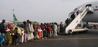 Chadian evacuees board a plane to Chad from Central African Republic, February 2014