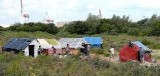 A cluster of makeshift settlements in Calais, France, erected by migrants, asylum seekers and refugees, most of who want to travel to the United Kingdom