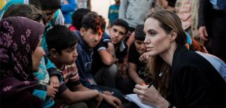 UNHCR Special Envoy, Angelina Jolie, speaks with newly arrived Syrian refugees in a Jordanian military camp at the border between Syria and Jordan. Jolie traveled to Jordan's border with Syria on 18 June at the start of a visit to mark World Refugee Day