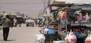 The main market street in Al Za'atari refugee camp, Jordan, nicknamed the 'Champs-Élysées'