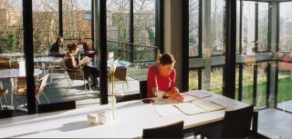 Studying in the cafeteria at the Manor Road Building, home of the Social Sciences Library