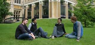 Students sitting on grass at Balliol College