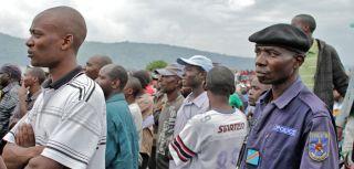 Police and civilians listen to an address by M23 spokesman Lt Vianney Kazarama in Goma yesterday