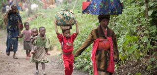 Congolese civilians carry their belongings as they escape the recent fighting between Congolese government forces and rebels, Democratic Republic of Congo