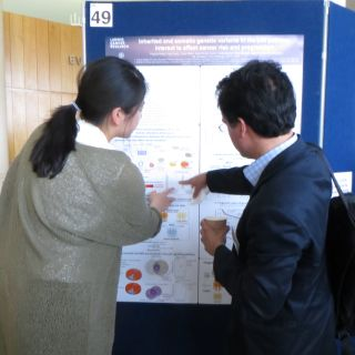 A photo of a student presenting their research poster