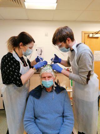 A volunteer participant undergoing an MEG scan.