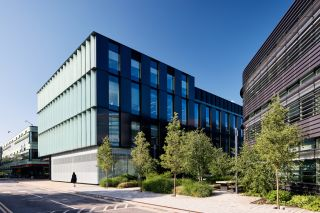 The Kennedy sits alongside the Big Data Institute (r) and the Old Road Campus Research building (l) at the heart of the University of Oxford's biomedical research