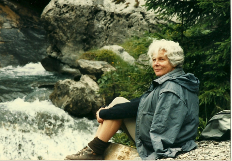 Marianne Fillenz sitting by a stream